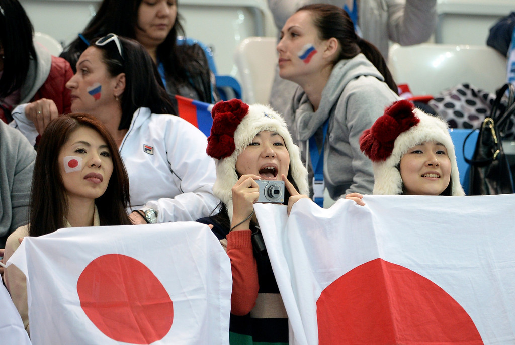 . Japanese fans attend the Men\'s Figure Skating Short Program at the Iceberg Skating Palace during the Sochi Winter Olympics on February 13, 2014. JUNG YEON-JE/AFP/Getty Images