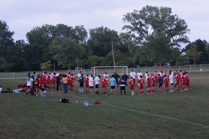 2012 soccer teams & alumni join together in prayer after the 10th annual Alumni Soccer Games at Lutheran West.