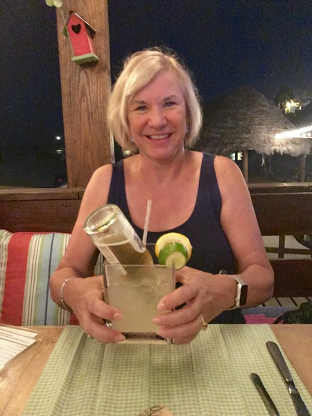 Woman holding a square glass with a beer margarita in it
