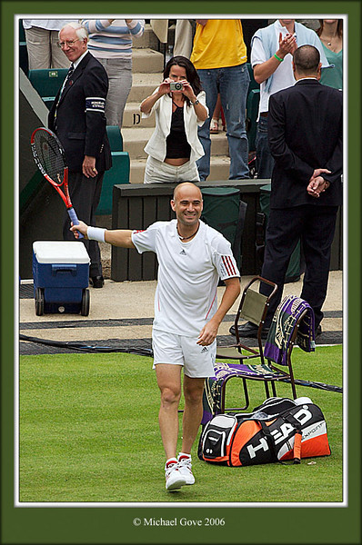 Agassi entering court (62631429).jpg