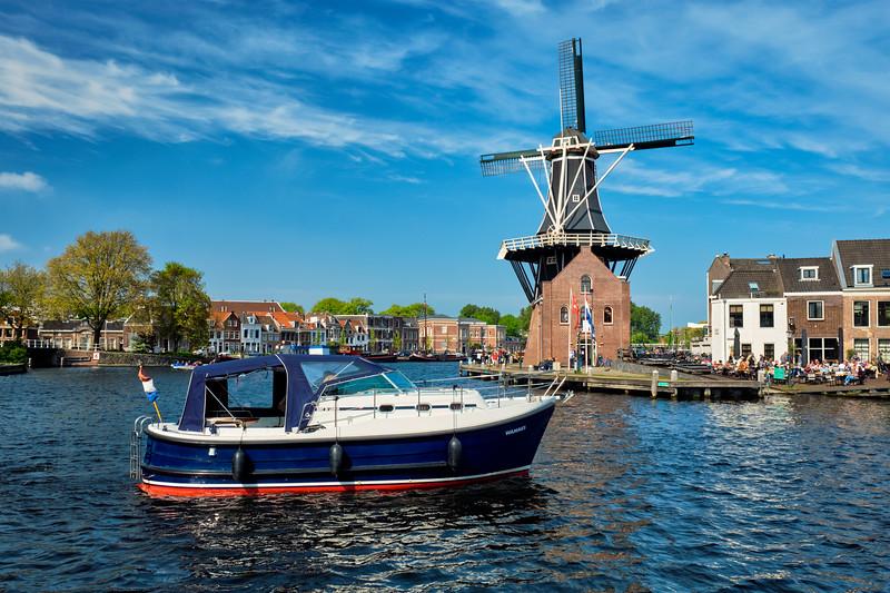 Harlem landmark  windmill De Adriaan and boat on Spaarne river. Haarlem,  Netherlands