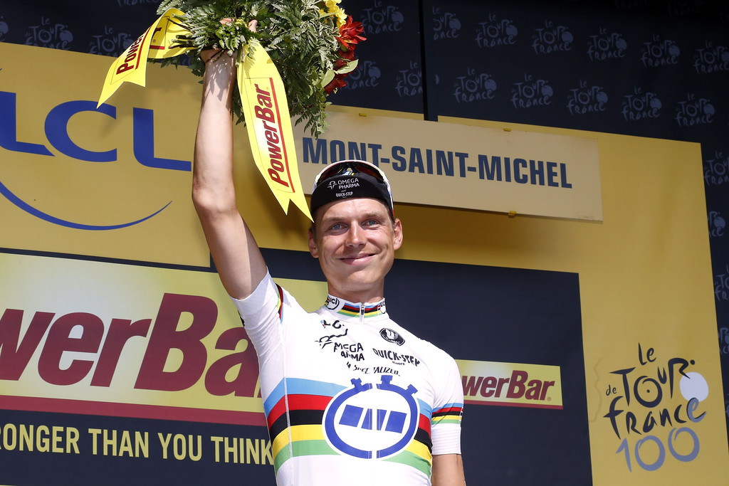 . Stage winner Germany\'s Tony Martin celebrates on the podium after winning the 33 km individual time-trial and eleventh stage of the 100th edition of the Tour de France cycling race on July 10, 2013 between Avranches and Mont-Saint-Michel, northwestern France.     JOEL SAGET/AFP/Getty Images