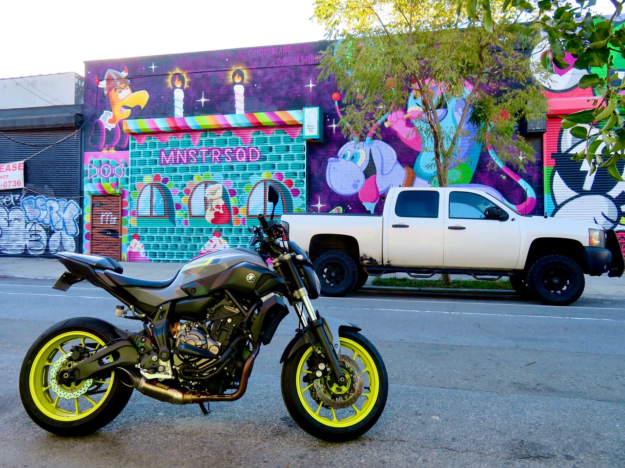 yamaha fz07 motorcycle parked in front of mnstrsqd street art patch whisky ghostbeard