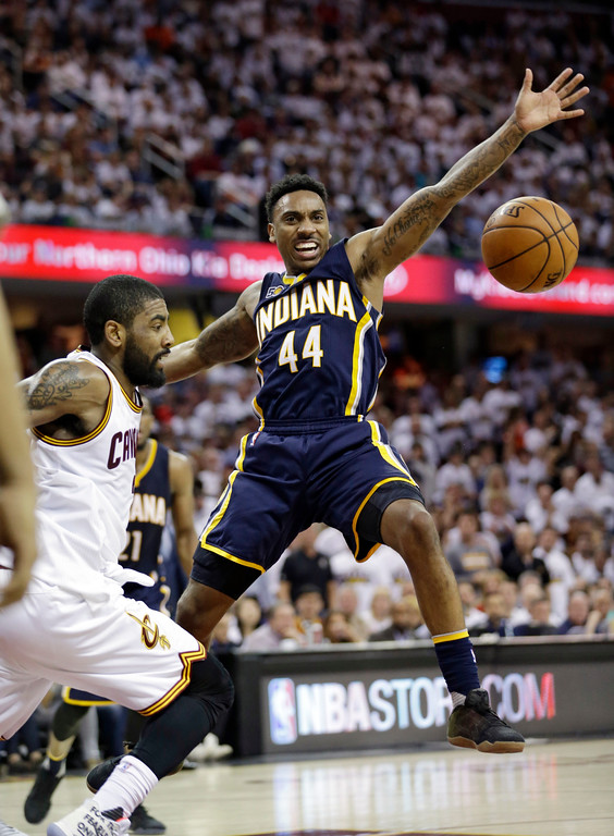 . Cleveland Cavaliers\' Kyrie Irving, left, knocks the ball loose from Indiana Pacers\' Jeff Teague in the second half in Game 1 of a first-round NBA basketball playoff series, Saturday, April 15, 2017, in Cleveland. The Cavaliers won 109-108. (AP Photo/Tony Dejak)