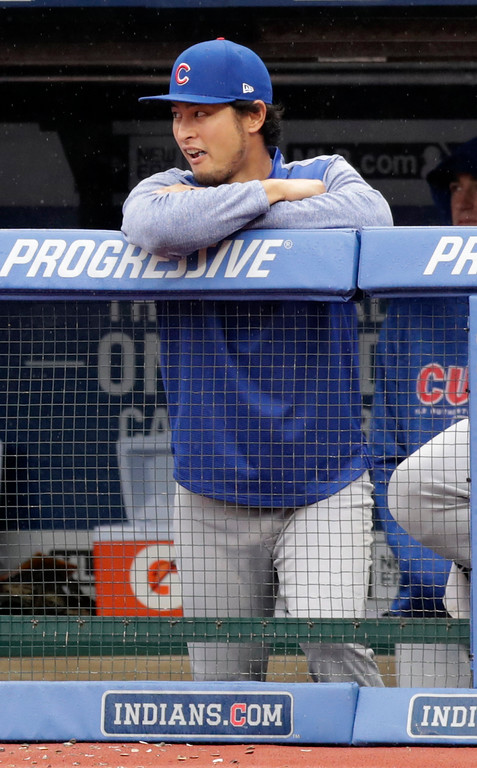 . Chicago Cubs pitcher Yu Darvish watches from the dugout in the first inning of a baseball game against the Cleveland Indians, Tuesday, April 24, 2018, in Cleveland. (AP Photo/Tony Dejak)