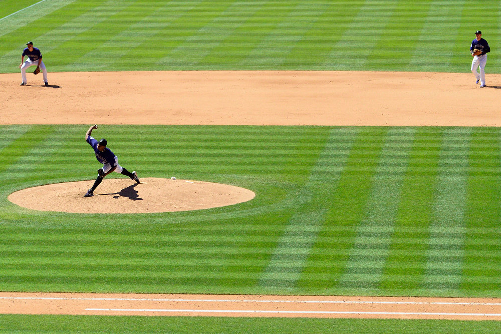 . Colorado Rockies starting pitcher Juan Nicasio (44) pitched 5 1/3 perfect innings before giving up a home run to San Diego Padres catcher Nick Hundley (4) on this pitch to end the streak during the sixth inning in Denver. The Colorado Rockies hosted the San Diego Padres at Coors Field on Sunday, June 9, 2013. (Photo by AAron Ontiveroz/The Denver Post)