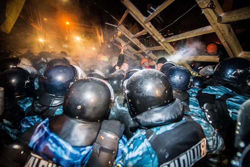 ". Riot police assaults a  barricade held by protesters on Independence Square  in Kiev late on December 11, 2013. Ukrainian security forces on Wednesday stormed Kiev\'s Independence Square which protesters have occupied for over a week but the demonstrators defiantly refused to leave and resisted the police in a tense standoff. Eite Berkut anti-riot police and interior ministry special forces moved against the protestors at around 2:00 am (midnight GMT) in a move that prompted US Secretary of State John Kerry to express ""disgust\"" over the crackdown. DMITRY SEREBRYAKOV/AFP/Getty Images"