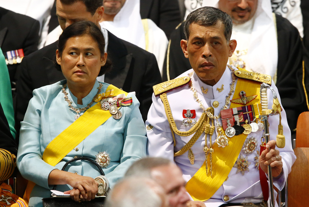 . Thailand\'s Crown Prince Vajiralongkorn (R) and Princess Sirindhorn await the start of the inauguration of King Willem-Alexander at Nieuwe Kerk or New Church in Amsterdam on April 30, 2013.  MICHAEL KOOREN/AFP/Getty Images