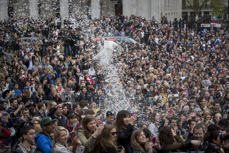 . Revelers take part in a giant pillow fight on the north terrace of Trafalgar Square on \'International Pillow Fight Day\' on April 5, 2014 in London, England.  Pillow fights have been organized in numerous other cities around the world simultaneously.  (Photo by Rob Stothard/Getty Images)