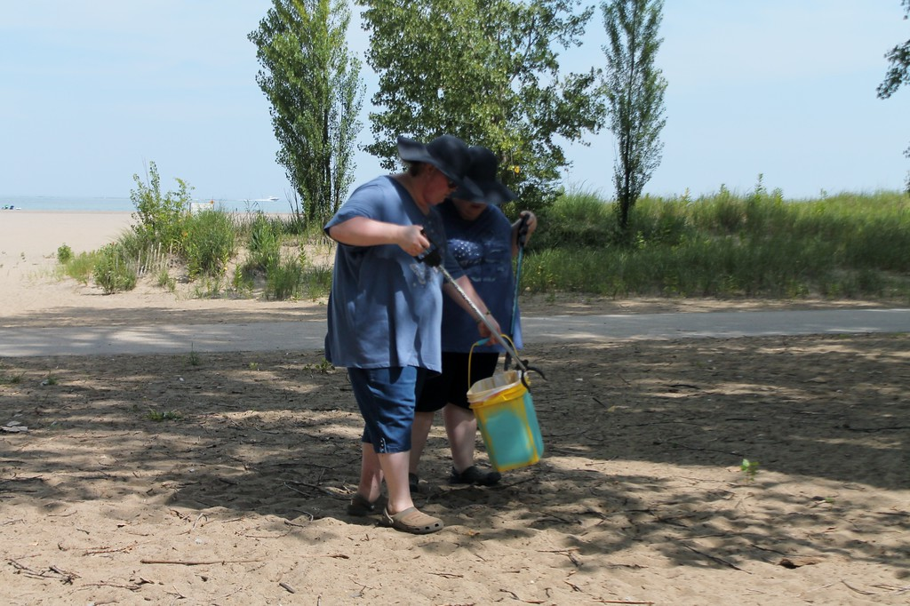 . Kristi Garabrandt � The News-Herald <br> Sisters Cody and Kayla participate in Lake County Board of DD/Deepwood Recreation Service Program\'s beach clean up project at Mentor Headlands Beach.
