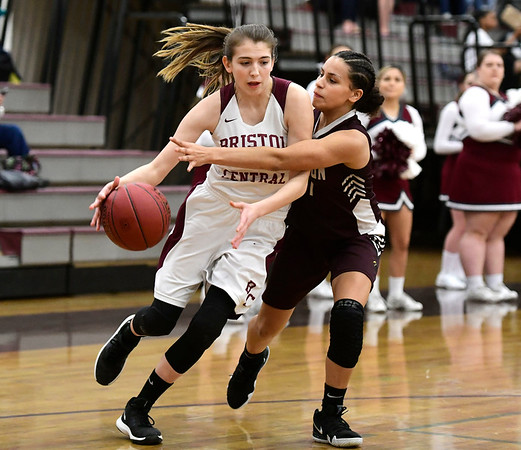 2/8/2019 Mike Orazzi | Staff Bristol Central's Allison Jessie (2) and Innovation's Ariana Rivas (11) during Friday night's girls basketball game in Bristol.