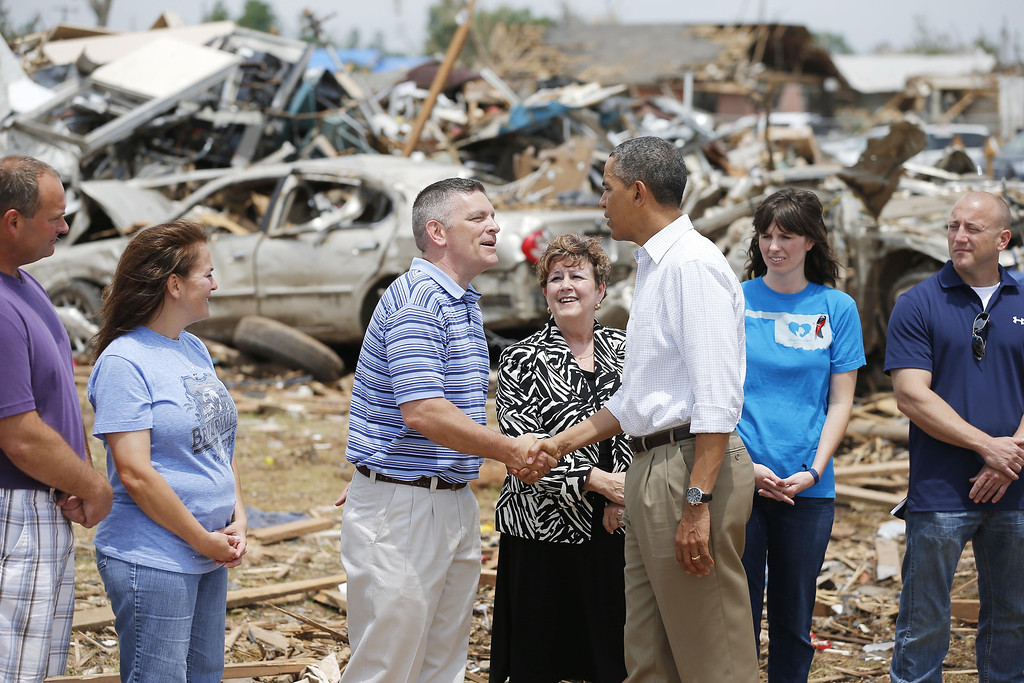 ". President Barack Obama greets Robert Romines, Asst. Superintendent, Personnel for Moore Schools, and Susan Pierce, Superitendent of Moore Schools, and tornado victims at Plaza Towers Elementary in Moore, Okla., on Sunday, May 26, 2013. Obama visited tornado-devastated Moore, Oklahoma, consoling people staggered by the loss of life and property and promising that the government will be behind them ""every step of the way.\"" (AP Photo/The Oklahoman, Bryan Terry, Pool)"