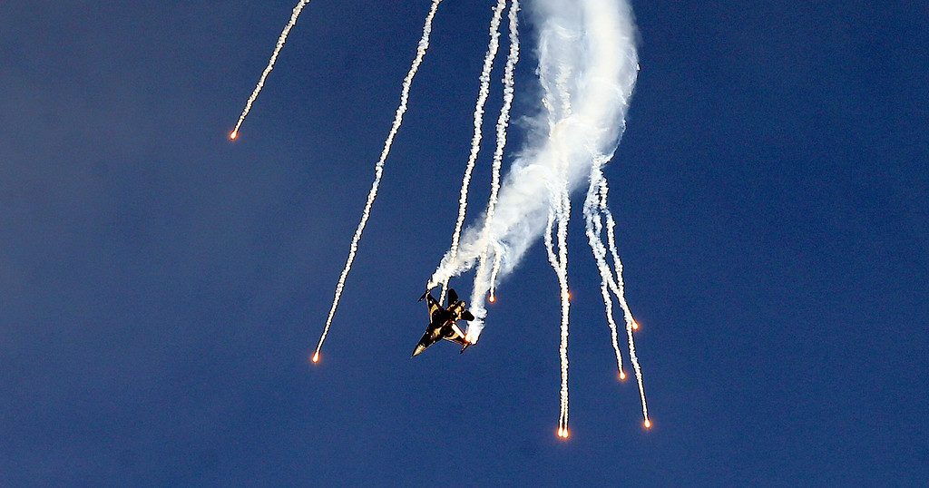 . A Turkish Air Force Lockheed Martin F-16 performs at the ILA Berlin Air Show 2014 in  Berlin Germany,  Wednesday May 21, 2014.   (AP Photo/dpa, Bernd Settnik)