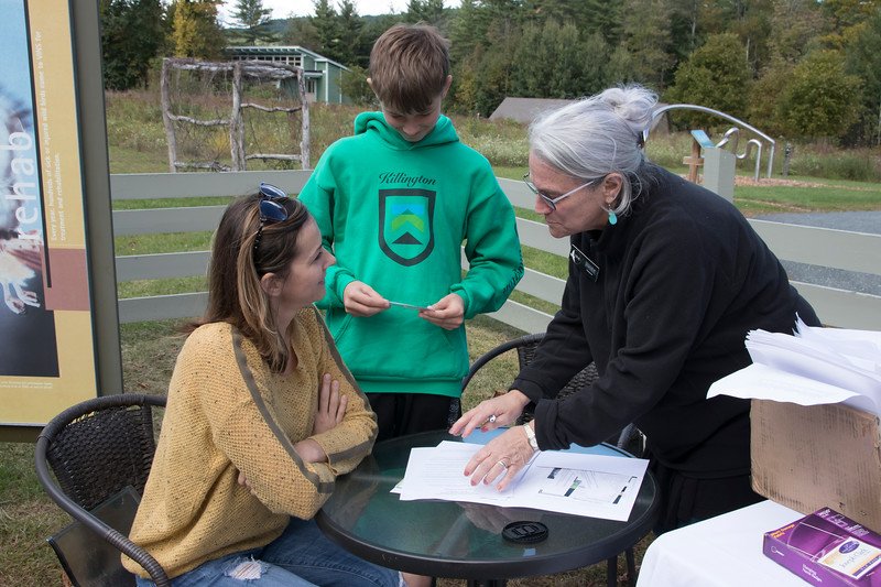 shumskis05-VINS_volunteer_Zooey_Zullo_helping_Agata_Marzec_and_her_son_Kuba_complete_their_registration.jpg