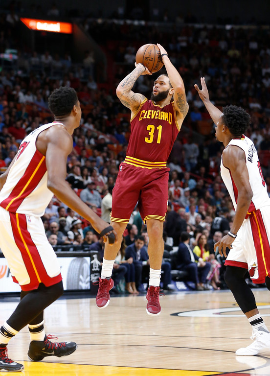 . Cleveland Cavaliers guard Deron Williams (31) goes up for a shot against Miami Heat center Hassan Whiteside, left, and guard Josh Richardson during the first half of an NBA basketball game, Monday, April 10, 2017, in Miami. (AP Photo/Wilfredo Lee)