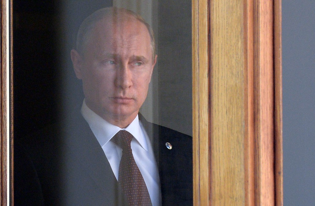 . Russias President Vladimir Putin waits for heads of state at the start of the G20 summit on September 5, 2013 in Saint Petersburg.   AFP PHOTO / YURI KADOBNOV/AFP/Getty Images