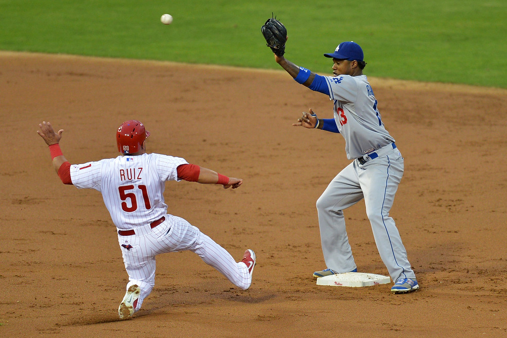 . PHILADELPHIA, PA - AUGUST 16: Hanley Ramirez #13 of the Los Angeles Dodgers puts out Carlos Ruiz #51 of the Philadelphia Phillies at second base in the third inning at Citizens Bank Park on August 16, 2013 in Philadelphia, Pennsylvania. (Photo by Drew Hallowell/Getty Images)