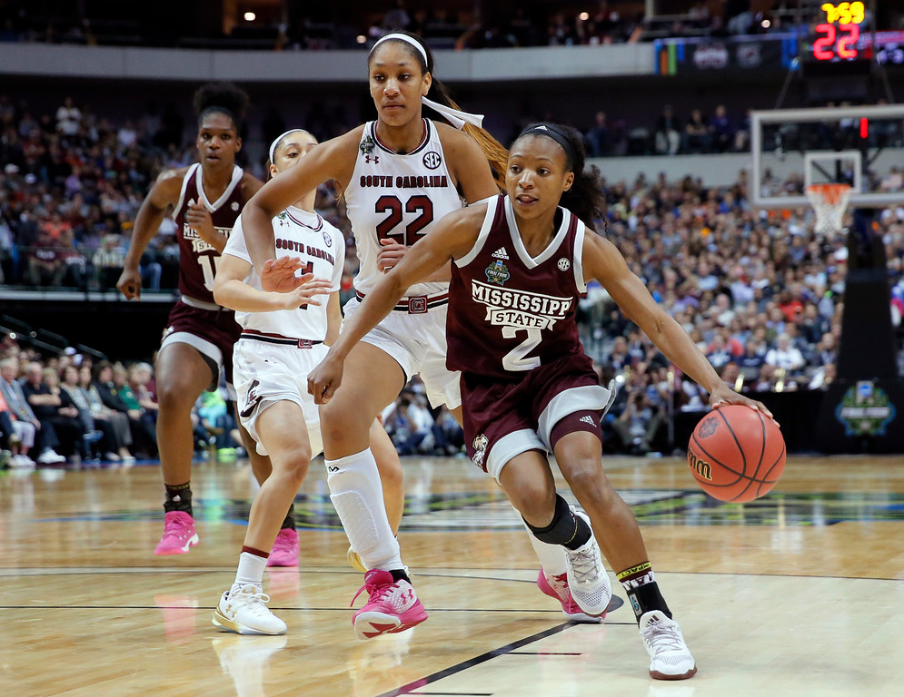 . Mississippi State guard Morgan William (2) drives around South Carolina forward A\'ja Wilson (22) during the first half in the final of NCAA women\'s Final Four college basketball tournament, Sunday, April 2, 2017, in Dallas. (AP Photo/Tony Gutierrez)