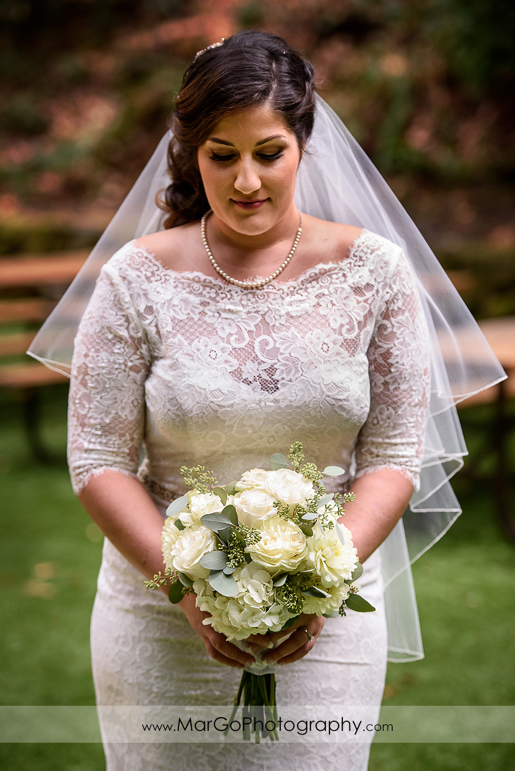 3/4 portrait of bride in white dress holding wedding bouquet at Saratoga Springs Cathedral Grove