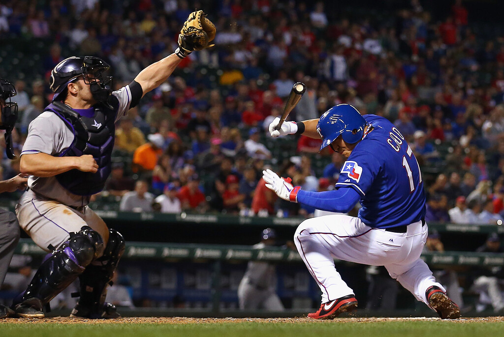 . ARLINGTON, TX - MAY 08:  Michael McKenry #8 of the Colorado Rockies pulls in a wild pitch as Shin-Soo Choo #17 of the Texas Rangers reacts in the bottom of the seventh inning at Globe Life Park in Arlington on May 8, 2014 in Arlington, Texas.  (Photo by Tom Pennington/Getty Images)