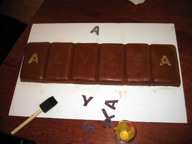 After the letters are embossed (using paper stencils), they are painted with edible gold dust