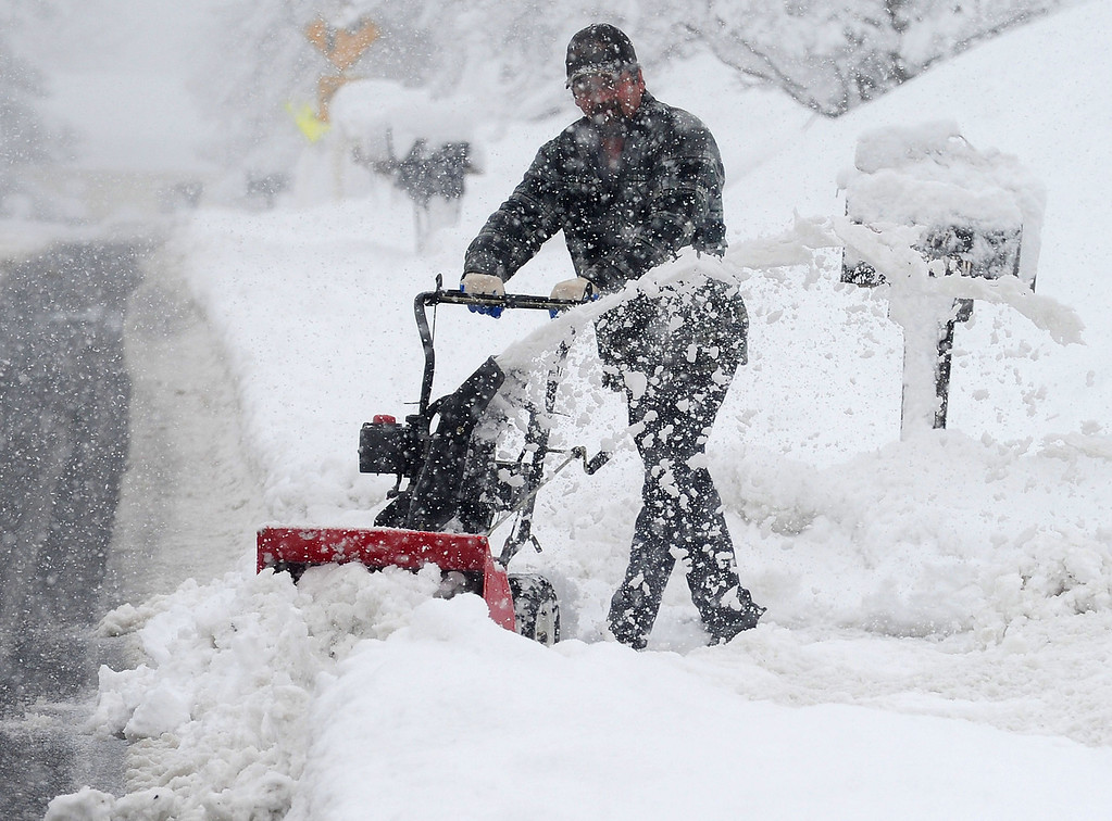 . Jimmy Floyd uses a snow blower to clear the snow from the end of his driveway during the largest winter storm of the season so far in Staunton, Va., on Wednesday, March 6, 2013. Gov. Bob McDonnell has declared a state of emergency in Virginia, as snow continues to pile up and knock out power to electric customers. (AP Photo/The Staunton News Leader, Mike Tripp)