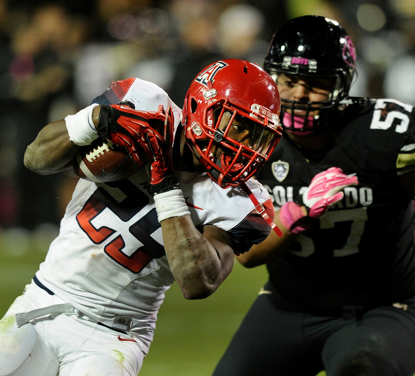 . BOULDER, CO. - OCTOBER 26: Arizona tailback Ka\'Deem Carey (25) punched the ball into the end zone for a touchdown in the second half. The University of Colorado football team hosted Arizona Saturday night, October 26, 2013. Photo By Karl Gehring/The Denver Post