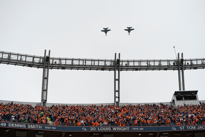 . Fighter jets fly over the stadium at the end of the national anthem. The Denver Broncos played the Indianapolis Colts in an AFC divisional playoff game at Sports Authority Field at Mile High in Denver on January 11, 2015. (Photo by John Leyba/The Denver Post)