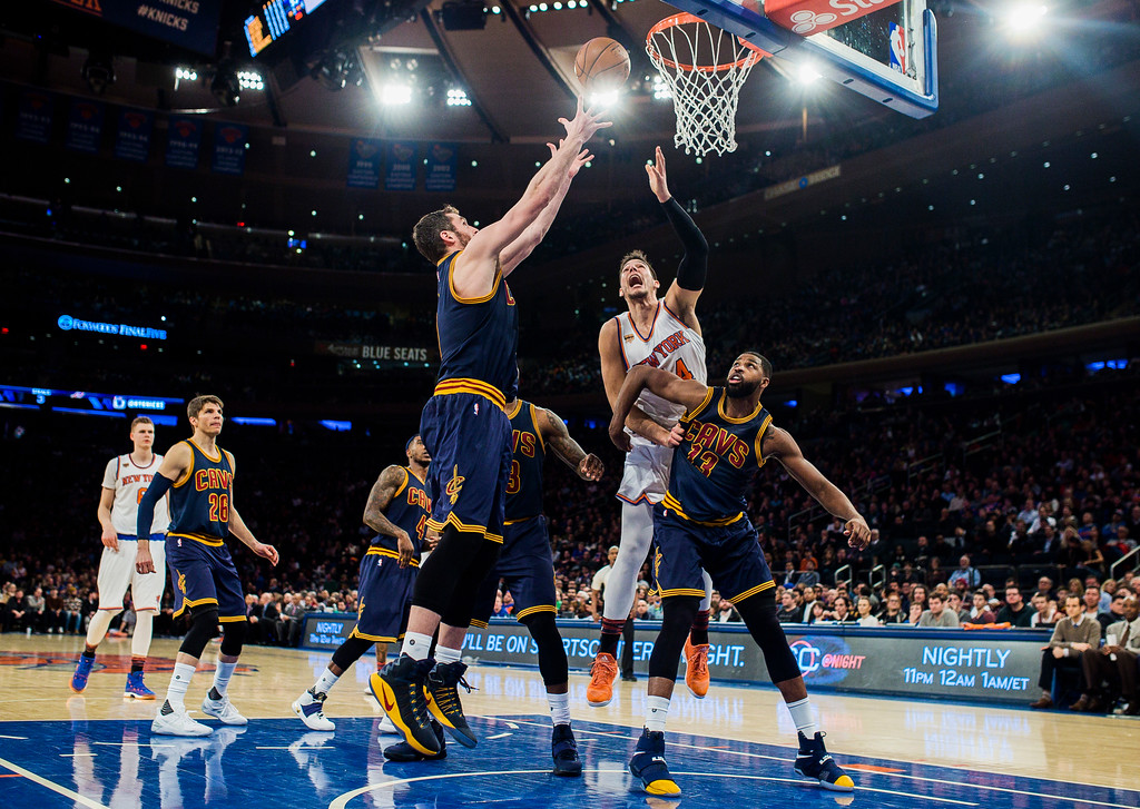 . Cleveland Cavaliers\' Kevin Love, top left, competes for the ball with New York Knicks\' Willy Hernangomez (14), second from right, during the second half of an NBA basketball game, Saturday, Feb. 4, 2017, in New York. (AP Photo/Andres Kudacki)