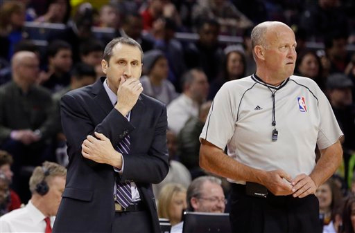. Cleveland Cavaliers head coach David Blatt and referee David Jones are seen during the first half of an NBA basketball game against the Detroit Pistons, Tuesday, Feb. 24, 2015 in Auburn Hills, Mich. (AP Photo/Carlos Osorio)