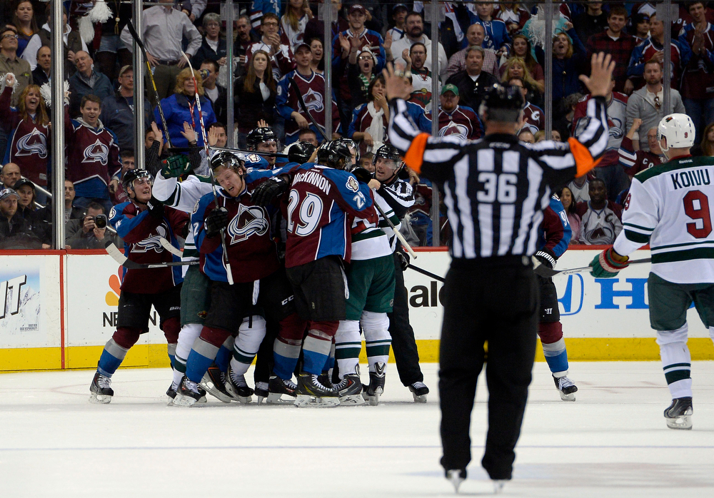 . A skirmish breaks out in the Avalanche zone during the third period of action. The Colorado Avalanche hosted the Minnesota Wild for the first playoff game at the Pepsi Center on Thursday, April 17, 2014. (Photo by John Leyba/The Denver Post)