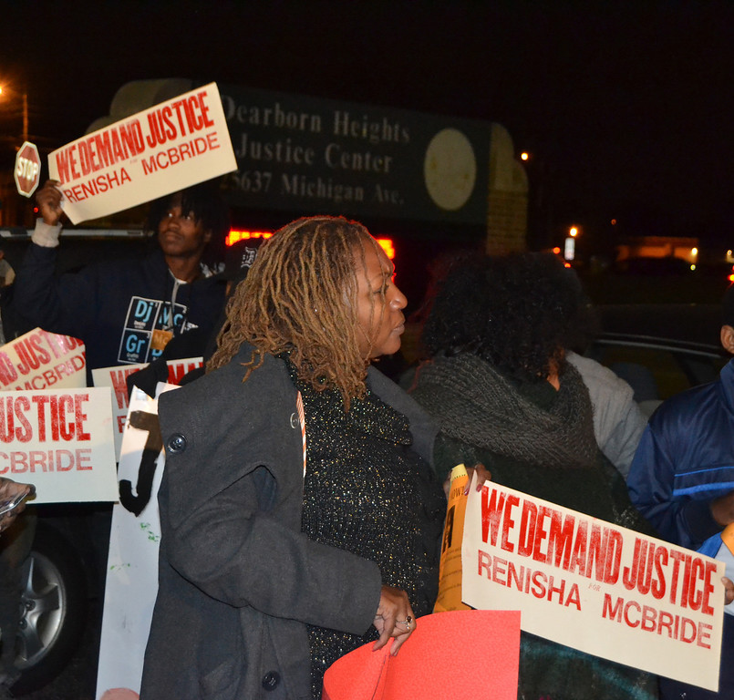 . Dozens of people hold �We Demand Justice� signs in a protest in at the Dearborn Heights Police Department on Thursday.