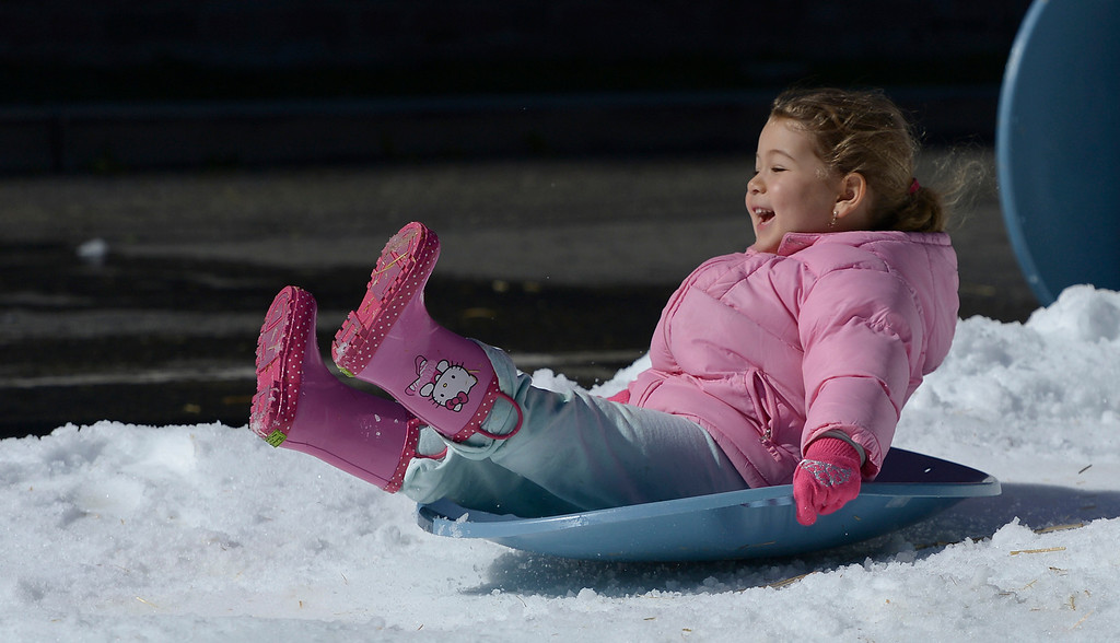 . Delpheen Tseikhin,4, picks up speed on her little sled. The Armenian Relief Society is hosting a two-day Winter Wonderland event this weekend, with snow, entertainment, games and amusement rides. Held at the Armenian Apostolic Church in Glendale.  Los Angeles , CA. February 1, 2014 (Photo by John McCoy / Los Angeles Daily News)