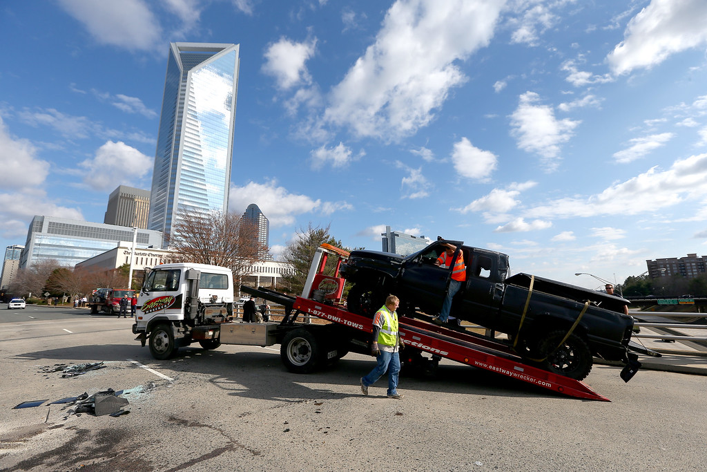 . A pickup truck belonging to quarterback Cam Newton of the Carolina Panthers, that was involved in a roll over accident, is loaded on to a flatbed in front of Bank of America Stadium on December 9, 2014 in Charlotte, North Carolina. Newton was transported from the scene in an ambulance after he was involved in a car accident.  (Photo by Streeter Lecka/Getty Images)