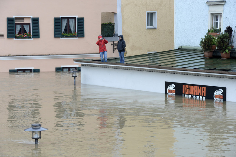 . Inhabitants wait for rescuers on the top of a overflooded shop in Passau, Bavaria, on June 3, 2013 as parts of the eastern and southern Germany were flooded due to heavy and ongoing rainfalls.  CHRISTOF STACHE/AFP/Getty Images