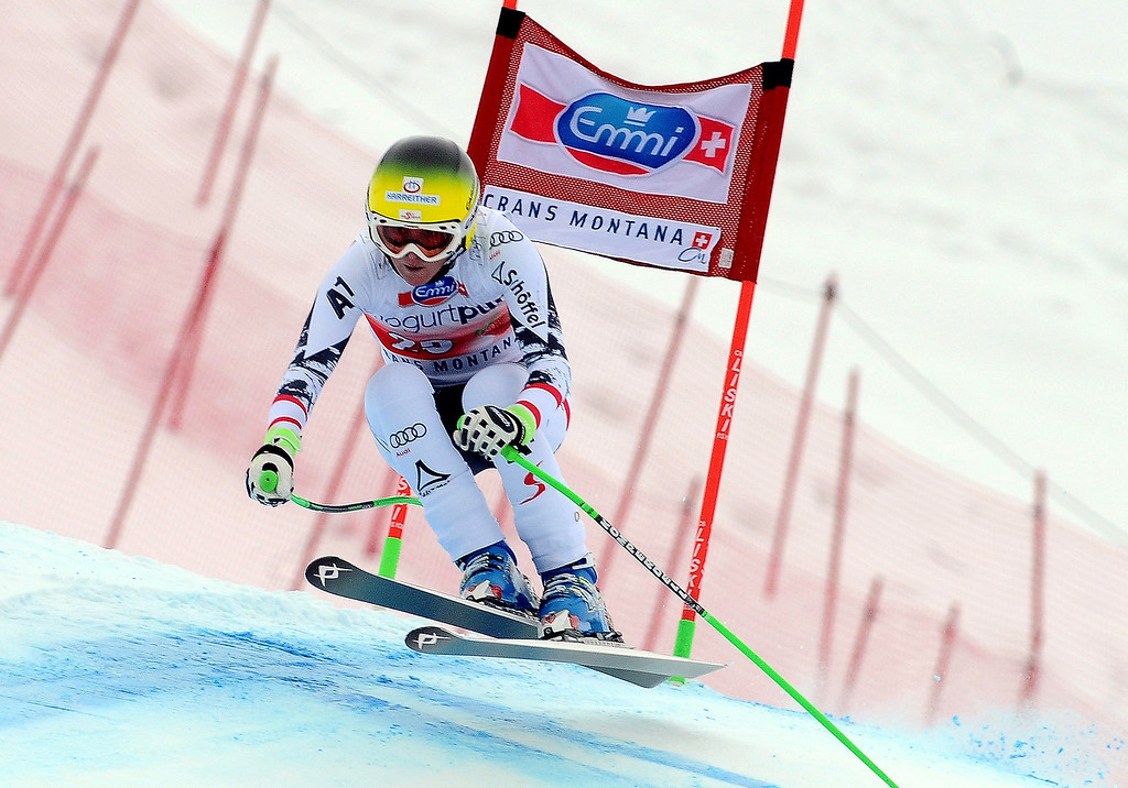 . Austria\'s Andrea Fischbacher clears a gate on her way to win an alpine ski, World Cup women\'s downhill, in Crans Montana, Switzerland, Sunday, March 2, 2014. (AP Photo/Pier Marco Tacca)