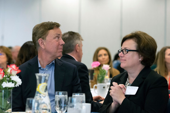 05/13/19 Wesley Bunnell | Staff Governor Ned Lamont spoke with the Central Connecticut Chambers of Commerce on Monday in Bristol. Governor Lamont looks at the podium as he is introduced to the chamber while seated next to Mayor Ellen Zoppo-Sassu.