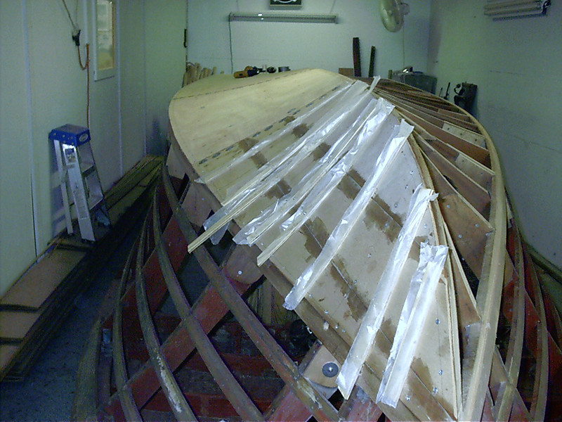 First layer of plywood installed on port side.