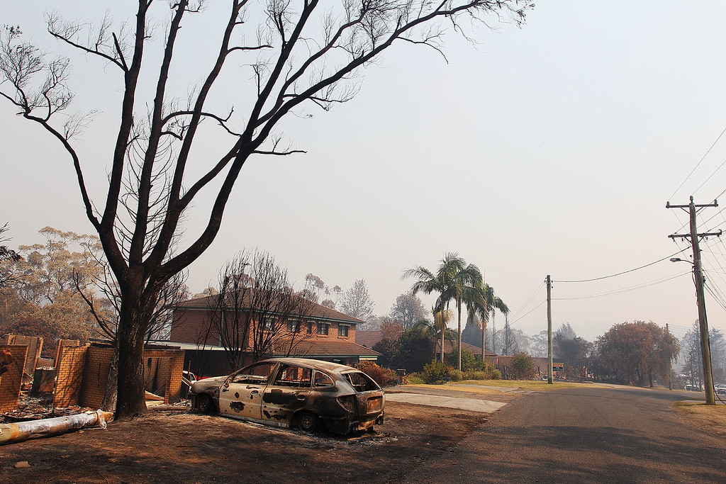 . A home and car destroyed by bushfire as seen on October 21, 2013 in Winmalee, Australia.   (Photo by Lisa Maree Williams/Getty Images)