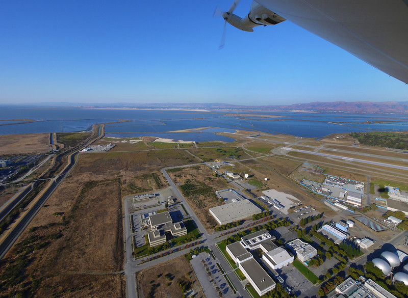 Moffett Field buildings and the San Francisco bay.