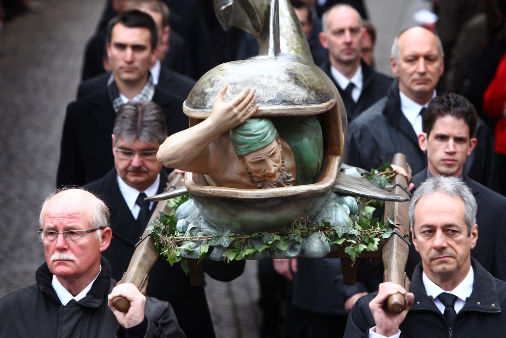 . Members of craftsmen guilds carry a statue of Jonah and the Whale during a Good Friday procession on April 18, 2014 in Lohr am Main, western Germany. The procession in Lohr am Main is one of the last remaining marches in Germany to depict the complete Easter story, beginning with the Last Supper and ending with the Christ\'s entombment.  (KARL-JOSEF HILDENBRAND/AFP/Getty Images)