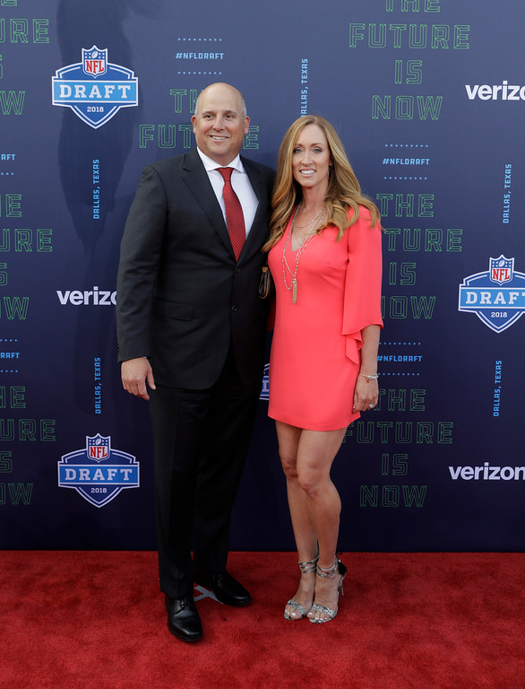 . Southern California head coach Clay Helton and guest before the first round of the 2018 NFL football draft, Thursday, April 26, 2018, in Arlington, Texas. (AP Photo/Eric Gay)