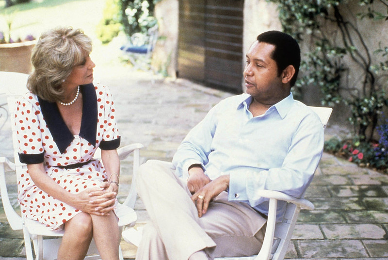 . Barbara Walters talks with exiled Leader Jean Claude Duvalier of Haiti. Duvalier spoke at his rented villa on June 12, 1986 in Grasse, France. (AP Photo)