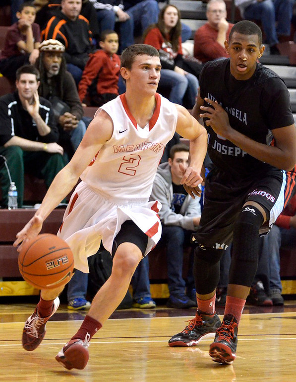 . Jeff Forman/JForman@News-Herald.com Kyle Hagey, Mentor, drives to the basket in the second quarter of VASJ\'s 82-71 loss to VASJ Sunday in the Dunk4Diabetes Shootout at Walsh University in North Canton.