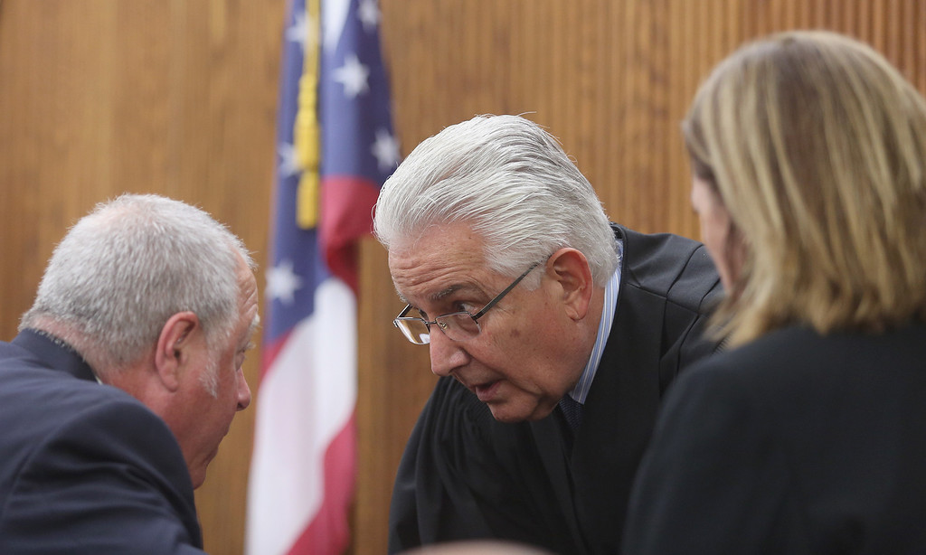 . Michael Allen Blair/MBlair@News-Herald.com Judge Joe Gibson talks with defense attorney Michael J. Connick and prosecutor Karen Kowall during Kevin Knoefel\'s murder conspiracy trial in Lake County Common Pleas Court on  June 3, 2014.
