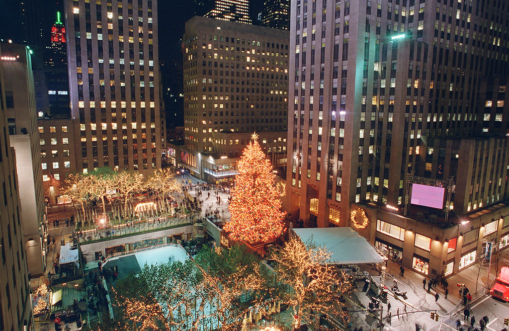 . The Rockefeller Center Christmas Tree stands lit in front of the General Electric building in New York\'s Rockefeller Plaza, during the 70th annual tree lighting ceremony Wednesday, Dec. 4, 2002 in New York.  (AP Photo/Mark Lennihan)