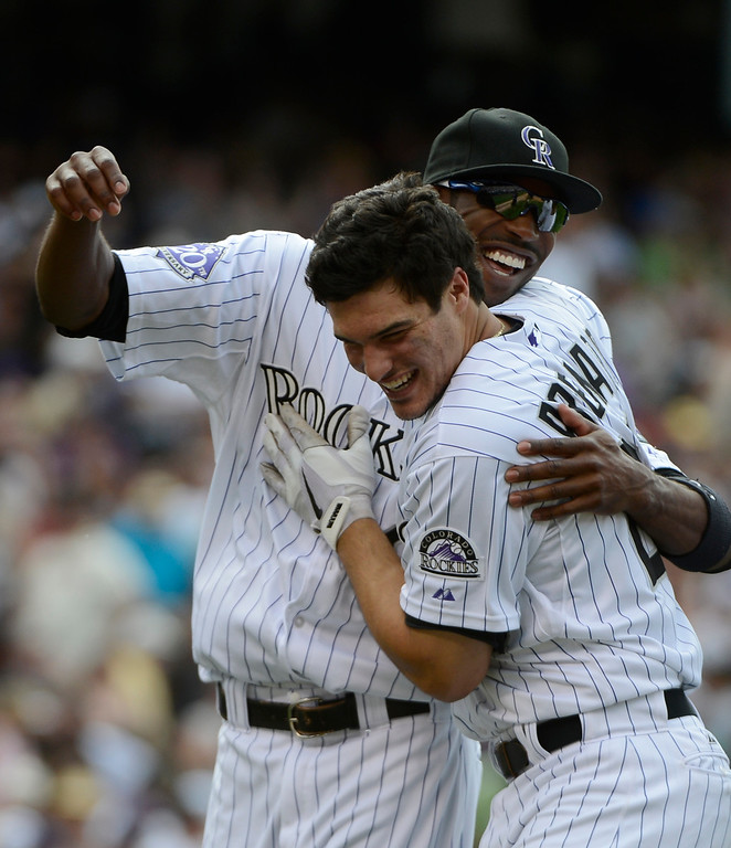 . DENVER, CO - JUNE 27: Colorado Rockies third baseman, Nolan Arenado, right, celebrates with injured teammate Dexter Fowler after hitting a walk-off game winning single to defeat the San Francisco Giants 2-1 at Coors Field Saturday afternoon, June 29, 2013. (Photo By Andy Cross/The Denver Post)
