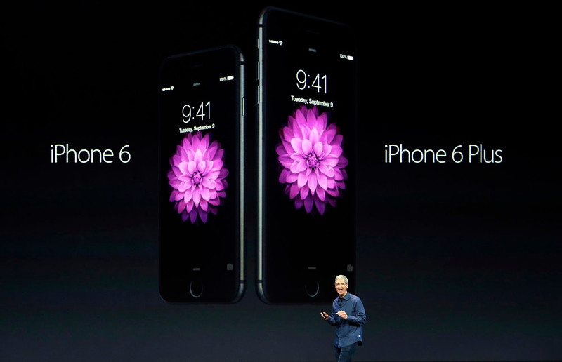 . Apple CEO Tim Cook introduces the new iPhone 6 and iPhone 6 Plus on Tuesday, Sept. 9, 2014, in Cupertino, Calif. (AP Photo/Marcio Jose Sanchez)