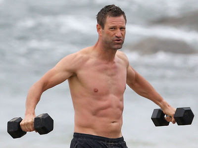 EXC: Aaron Eckhart Shows Off Ripped Body