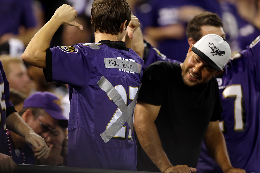 . A Baltimore Ravens fan has tape over his Ray Rice jersey during the first half of the Ravens\' NFL football game against the Pittsburgh Steelers on Thursday, Sept. 11, 2014, in Baltimore. (AP Photo/Patrick Semansky)